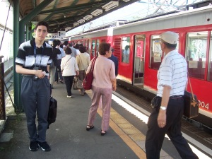 Jose stands next to the Hakone Tozan train in Gora. Photo by Jose Ramos, June 2004