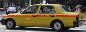 A typical Japanese taxi cab. Public domain photograph from Wikimedia Commons.